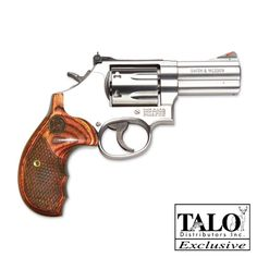 "medium size revolver, wood handle with the pinky grip. It's not ""the governor"" but it's perfect for the range"