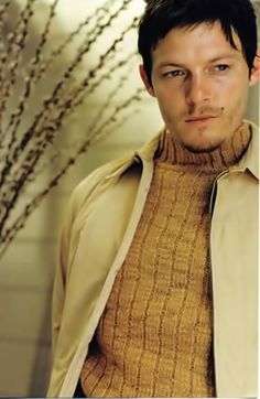 Norman Reedus. Younger. Like seeing him in another color other than black