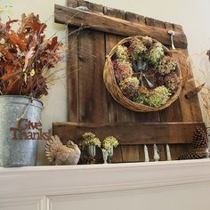 love the old barn door and fall decor. Pretty!