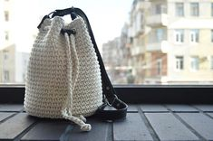 White crochet bag Basket bag Bucket bag Summer cotton bag Women summer accessory Shoulder bag Leather handle Purse women The unusual bag from my summer collection. This bag is made of thick cotton rope. The handle and the bottom of the bag are made of leather. The handle has of three elements and is regulated from 38 to 41 (97 - 104 sm). The handle and the bottom are stitched, that makes them stylish and durable. The bag has a beautiful inside lining and an inside pocket . 150 meters of…