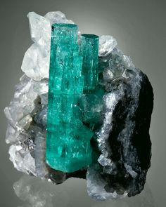Emerald with Calcite - Coscuez Mine, Boyaca Dept, Colombia Green Gemstones, Minerals And Gemstones, Rocks And Minerals, Stones And Crystals, Gem Stones, Mineralogy, Rocks And Gems, Gemstone Colors, Emeralds