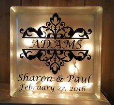 "This 7.75"" x 7.75"" glass block has a frosted front with the design of your choice. A string of 20 clear or multi-colored lights inside make this a great accent"