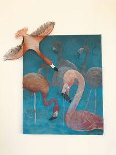 Flamingos spray paint in metal mesh