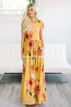 This beautiful maxi dress is flattering and so comfortable too! A stunning gold color, this incredibly soft dress features a watercolor lily print, short sleeves, gathered waist and side seam pockets.