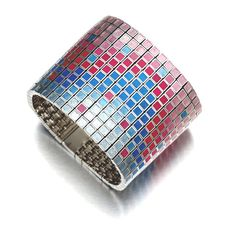 Handmade bracelet in silver and shades of blue and pink acrylic inlay. Consists of small blocks linked together to form a flexible mosaic matt.