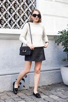 Trini | Sandro sweater T by Alexander Wang leather skirt Miu Miu loafers Saint Laurent Lulu bag