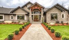 <ul><li>Beautiful decorative wood trim adorns the outside of this one level Mountain house plan.</li><li>Wide open spaces come into view as soon as you enter the foyer with the vaulted and beamed great room straight ahead.</li><li>Half walls keep the views flowing and interior columns and special ceiling treatments abound.</li><li>The kitchen is a chef's dream with two islands, a huge walk-in pantry and tons of counter space f...