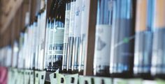 """Pick the perfect wine from Barrique's """"Wall of 100"""" wines under $10!"""