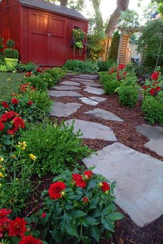 I love the pathway - mulch could eventually be replaced by smaller rocks and perennial ground cover like creeping thyme and creeping jenny