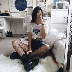 Printed top, denim shorts, oversized fishnet body leggings & Dr Martens boots by awkwrd.bby