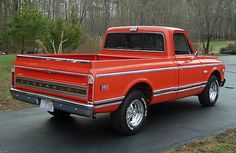 """1971 C10 in hugger orange with cool mag wheels and proper body trim.  I do believe that both C10s and C20s could be purchased in one solid color as shown.  Not all had a white roof and pillars.  As for the chrome strip on the tailgate, I like it but it might be a bit too blingy to have been an option back in the day.  But again:  """"I could be wrong"""" (tm)."""