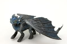 Hey, I found this really awesome Etsy listing at https://www.etsy.com/listing/221609479/toothless-night-fury-dragon-sculpture