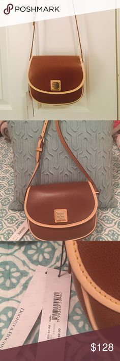 Dooney & Bourke Leather Crossbody Saddlebag. NWT. Dooney & Bourke Leather Crossbody Saddlebag. Absolutely beautiful. NWT. Brand New. Amber color. Dooney & Bourke Bags Crossbody Bags