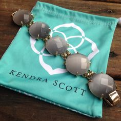 """Kendra Scott Cassie Bracelet New with dust bag, Kendra Scott """"Cassie"""" bracelet in slate cat eye color. 14K gold plated, fold-over clasp closure, 7.5"""" long and 1.125"""" at widest point.  Accepting offers, no trades please  Kendra Scott Jewelry Bracelets"""