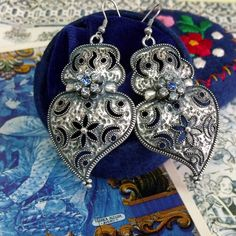 Portuguese folk jewelry Hearts of Viana silver tone earrings with vintage Blue rhinestones flowers. It is my modern aged version of the traditional style lacy hearts dangle earrings.$39.00...#portuguesefolkjewelry#portuguesevianahearts#madeinPortugal#portugaljewelry#bigsilverheartearrings#portugalfokjewelry