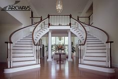Smart staircase designs create elegant functionality for Curved staircase
