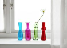 Mix and match different coloured vases for a striking effect.