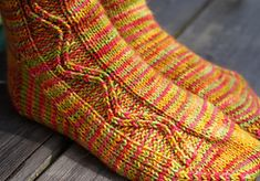 This pattern is my solution to the variegated yarn conundrum - that one where a gorgeous skein of yarn refuses to knit well in a pattern, but the thought of yet another totally stockinette sock is too monotonous to bear. Beginner Knitting Patterns, Knitting Designs, Knit Patterns, Knitting Projects, Knitting Socks, Knit Socks, Lace Socks, Ravelry, Knitted Slippers