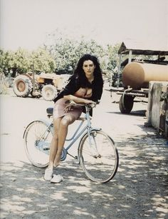 Monica Bellucci oh-so-casual on a bicycle. @Vasia Papazoglou