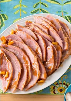 Slow-Cooker Party Ham -- The easiest, tastiest way to feed a crowd? This bone-in ham recipe--made tender, juicy and flavorful from a slow-cooker simmer in a sweet and savory sauce.