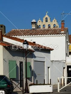 View from a street of the bell tower of the church of Notre Dame de la Mer in St Maries de la Mer, Camargue, France