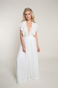 Flowy Wedding Dress with Lace Detail | Florence Darling | This halter wedding dress features a plunging v-neckline with guipure lace cap sleeves. The natural waist and chiffon skirt finish at the back leaving the brides back exposed. Visit our website to learn more about this v-neck flowy wedding dress. #wedding #weddinginspo #bride #weddingdress #bridalinspo #boho #bohobride #lace #halterweddingdress Wedding Dress Chiffon, Custom Wedding Dress, Elegant Wedding Dress, Wedding Bridesmaid Dresses, Chiffon Skirt, Lace Dress With Sleeves, Cap Sleeves, Country Wedding Dresses, Florence