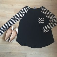 Long sleeve blouse! Long sleeve, chevron black and gold print blouse. Perfect with black pants, leggings, or jeans. Sleeves are see through. in9 Tops Blouses
