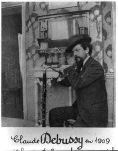 mudwerks:    locpix:    [Claude Achille Debussy, 1862-1918, three-quarters length, seated, facing left, wearing hat]    that looks like a Bass Clarinet!!!