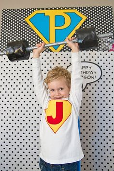 Super hero party photo op. looks more real than balloons...think it's toilet paper rolls??
