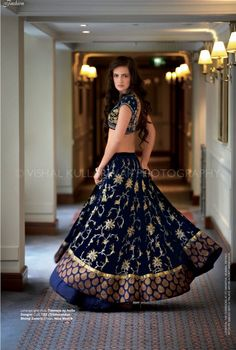 dark blue and gold lengha by Anita Dhongre