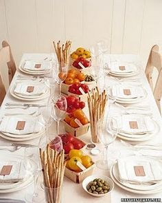 Bistro party - nice display of food - bread sticks in glasses and veggies in berry baskets.