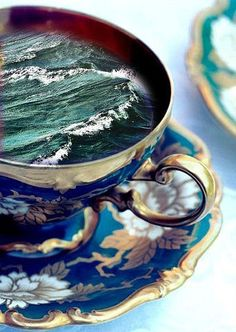 Scene inside a teacup - perfect inspiration (although it isn't painted) for what I want to develop in my second folio board