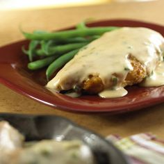 This quick cooking dish features seasoned browned chicken breasts cloaked in a smooth sauce made with sour cream, green onion and cream of chicken soup.