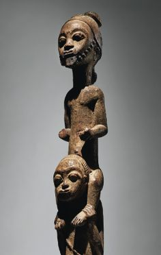 """CATALOGUE NOTES:Baulé statue double figure sotheby's..."""" Baule double figure, Côte d'Ivoire """"Asiè usu i klo yele waka sran: the village of the genius is the statue."""" Baule proverb. (Boyer, Baule, 2008, p. 34) Whilst the Baule sculptor never represents the departed, he takes quite particular care in executing sculptures which representing either spirit spouses from the other world or, as here, spirits called asie usu. According to Susan Vogel, theses nature spirits """"are extremely…"""