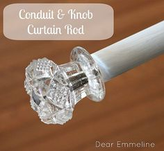 DIY curtain rod with conduit, dowel and drawer knobs.