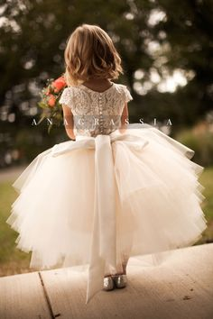 ANAGRASSIA flower girl dresses: ivory/champagne lace leotard & bodysuit with champagne/ivory/white tulle skirt and satin sash www.anagrassia.com