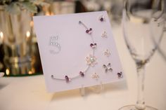 Hand quilled wedding table numbers with purple, silver and ivory colours