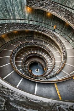 This is an example of radial balance because the design is balanced around the spiral stairs