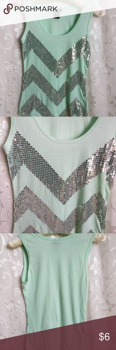 Rue 21 top Rue 21 top *** size Small, mint green with silver sequins chevron design on the front.  Good condition Length 23 inches long Width 14 inches across.  Smoke free environment.  Thanks for stopping by my closet..... Rue21 Tops Tank Tops
