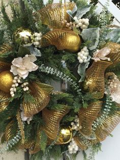 Wreath with baby cream magnolias, white berries, gold mesh ribbon and balls