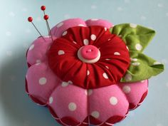 Cute pin cushion, featuring polka dots AND rick rack.