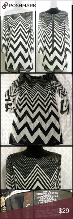 Chevron Dress Black/White (off white) Chevron Dress with zipper back, and with faux leather shoulder accents. Good, pre-owned condition. 100% polyester (light, flowy feel). Super cute! Perfect with leggings and boots or heels to dress up! Fire Los Angeles Dresses Midi
