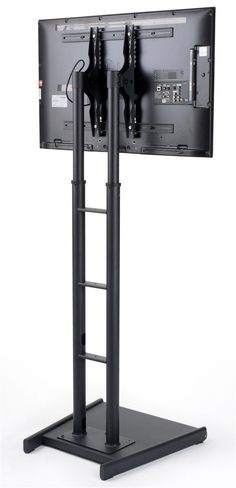 Buy a large TV stand with 10 height adjustable positions from This black plasma display offers tilt, rollers, and in-post cable management! Tall Tv Stands, Large Tv Stands, Lcd Tv Stand, Flat Screen Tv Stand, Lcd Television, Base, The Unit, Digital, Shopping