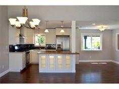 This centrally located home has been re-finished top to bottom! New flooring, new paint, new appliances, & new windows.     Unique master bathroom suite includes dual sinks and dual closets. Brand new kitchen opens to the great room for perfect entertaining and includes stainless steel appliances.    Italian porcelain countertops, large island with solid wood counter, and recessed LED lighting. Garage was converted to a in-law unit with separate entrance and its own kitchenette, full…