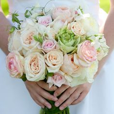 Cecily and George A pale pink bouquet of roses with bright green accents ties together to garden theme the couple was looking for.      Florist: Crystal Lilies   Image Credit- Altura Studio