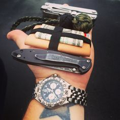 "One if my edc setups. Fossil watch. Kershaw leek. Minimalist wallet. Homemade blackjack from 1"" ball beating and 550 paracord. Leatherman blast modded w a pocketclip."