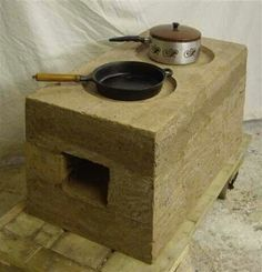 Earth Architecture - Entries from March 2010 Rammed Earth stoves in Malawi Stove Heater, Stove Oven, Outdoor Oven, Outdoor Cooking, Rocket Mass Heater, Rammed Earth Homes, Materiel Camping, Cooking Stove, Cooking Wine