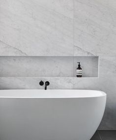 Love it all .. Bathtub , marble , taps even the Aesop!
