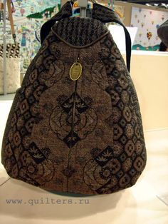 from Quilting Festival in Tokyo, page of bags made with quilting techniques ~ love this one!