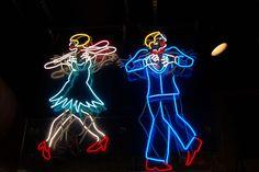 Neon swing dancers